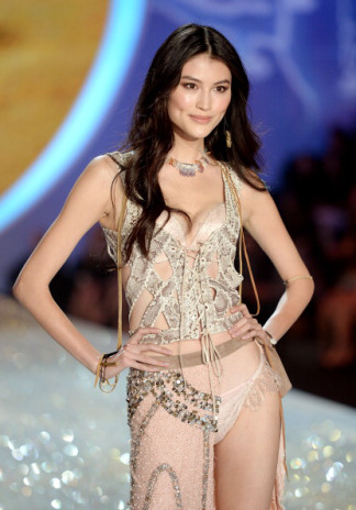 Sui He, in Lost Art snakeskin vest, at the 2013 Victoria's Secret Fashion Show at Lexington Avenue Armory on November 13, 2013 in New York City.  Photo by Dimitrios Kambouris